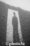 Sombra en la puerta